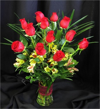 Dozen Red Roses with Palm Leaves