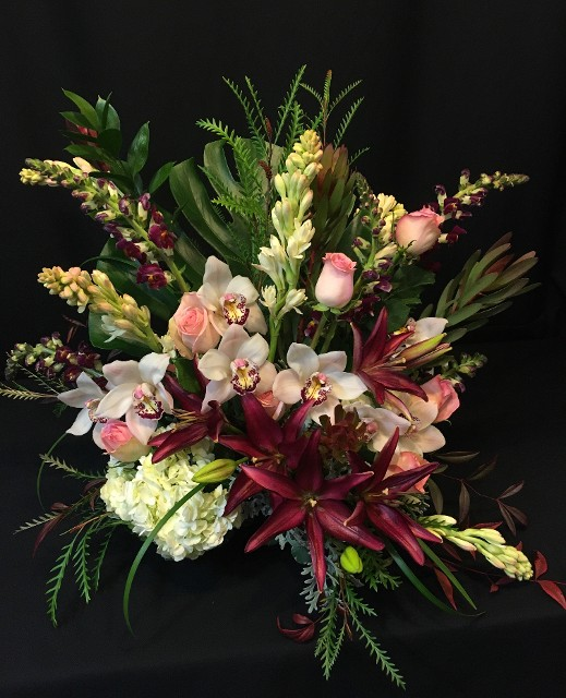 Tropical display of Roses Lilies and Cymbidium for valentine delivery