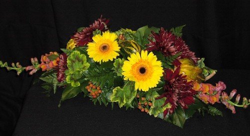 Thanksgiving centerpiece long & low with garnet king mums and gourds
