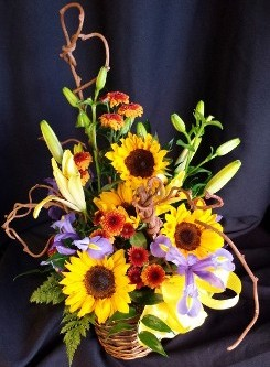 Fall mixed flower basket with sunflowers and branches