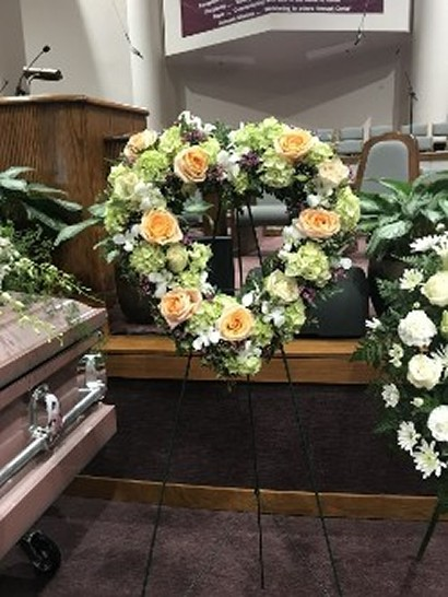 heart wreath on easel classic funeral flowers