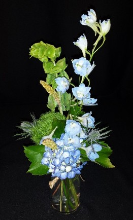 vintage bud vase of blue flowers