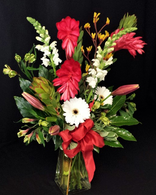 ginger display in rectangular vase tropical flowers for delivery